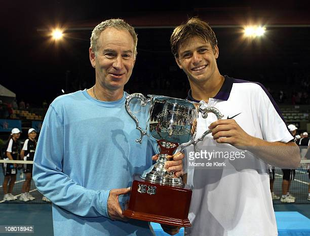 John McEnroe and Ryan Harrison of Team USA poses with their trophy for winning the tournament after day three of the World Tennis Challenge at...