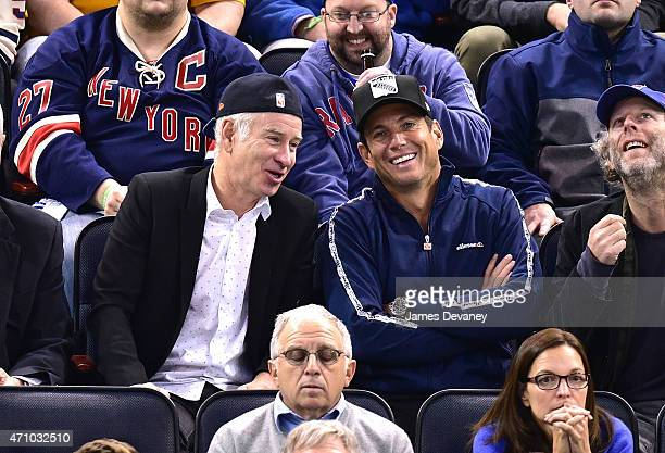 John McEnroe and Will Arnett attend the Pittsburgh Penguins vs New York Rangers playoff game at Madison Square Garden on April 24 2015 in New York...