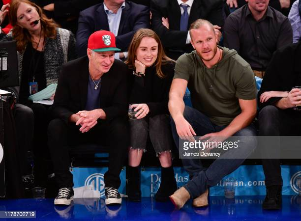 John McEnroe Anna McEnroe and Noah Syndergaard attend Chicago Bulls v New York Knicks game at Madison Square Garden on October 28 2019 in New York...