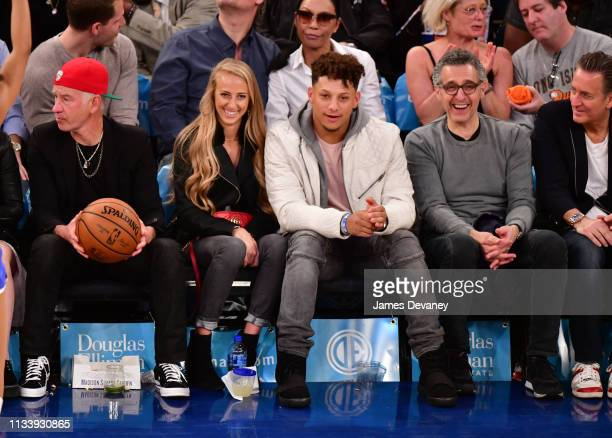 John McEnroe Brittany Matthews Patrick Mahomes and John Turturo attend Miami Heat v New York Knicks game at Madison Square Garden on March 30 2019 in...