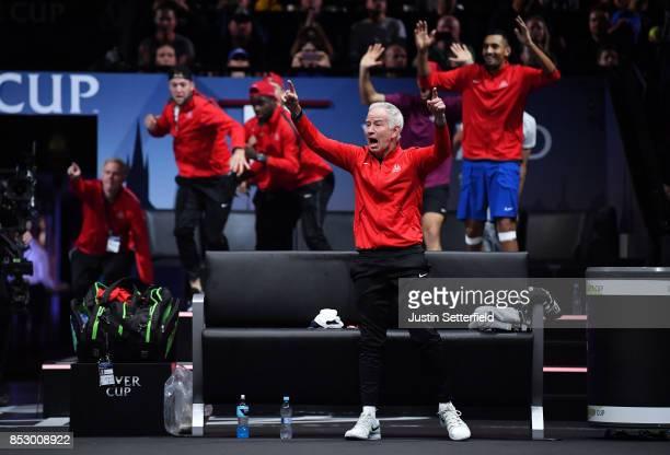 John Mcenroe Captain of Team World celebrates as John Isner of Team World wins match point during his mens singles match against Rafael Nadal of Team...