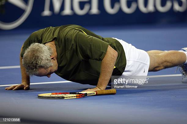 John McEnroe doing pushup's after misplaying a return from Jim Courier during exhibition play at the Mercedes Benz Classic Tennis Tour at Chicago's...