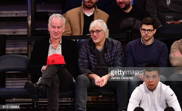 John McEnroe guest and Jerry Ferrara attend the New York Knicks vs Milwaukee Bucks game at Madison Square Garden on February 6 2018 in New York City