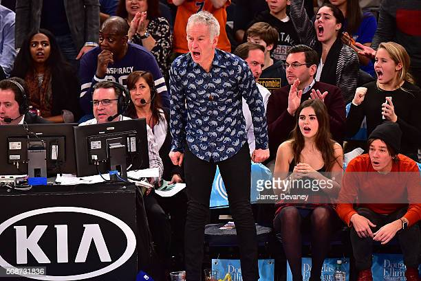 John McEnroe his daughter and Nate Ruess attend the Memphis Grizzlies vs New York Knicks game at Madison Square Garden on February 5 2016 in New York...