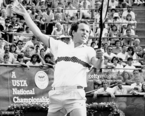 John McEnroe laces into a return during his first round US Open match against Shlomo Glickstein of Israel who pushed the defending champion to a...