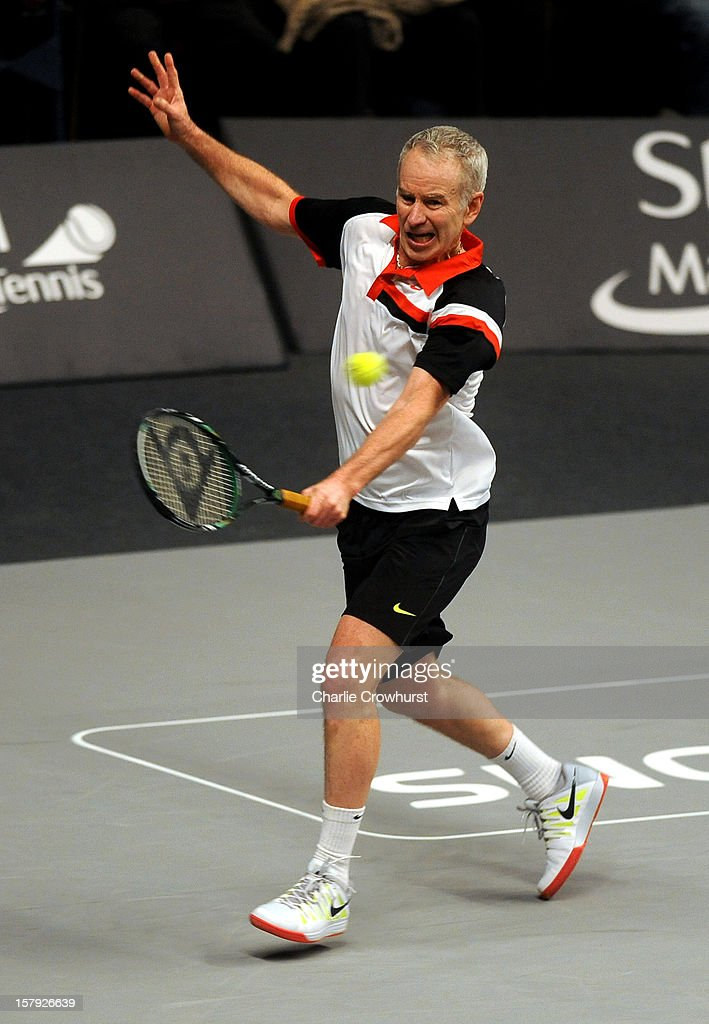 John McEnroe of America hits a backhand during the match against Guy Forget of France on Day Three of the Statoil Masters Tennis at the Royal Albert Hall on December 7, 2012 in London, England.