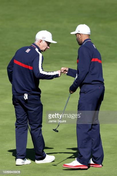 John McEnroe of Team USA and James Blake of Team USA celebrate during the celebrity challenge match ahead of the 2018 Ryder Cup at Le Golf National...