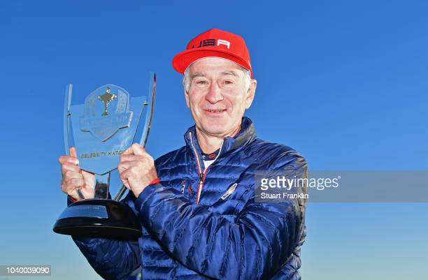 John McEnroe of Team USA celebrates victory with the trophy after the celebrity challenge match ahead of the 2018 Ryder Cup at Le Golf National on...