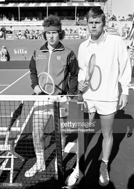 John McEnroe of the United States and Buster Mottram of Great Britain pose before their match during the 1978 Davis Cup Final at the Mission Hills...