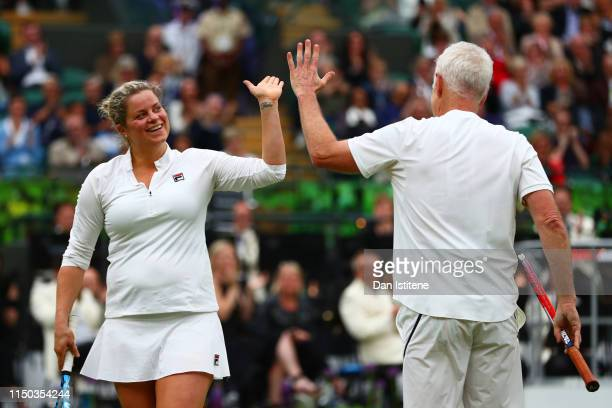 John McEnroe of the United States and his partner Kim Clijsters of Belgium celebrate a point during the mixed doubles match between John McEnroe of...