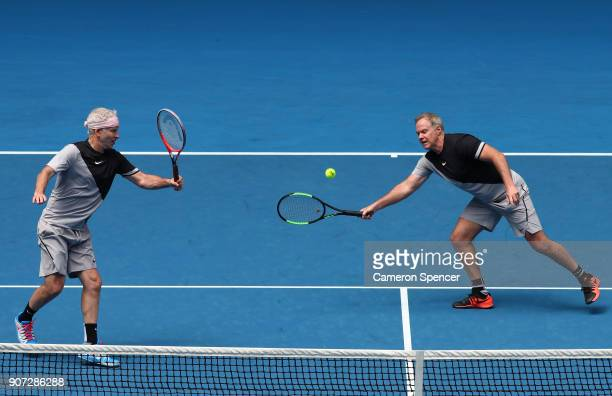 John McEnroe of the United States and Patrick McEnroe of the United States compete in their legend's match against Mats Wilander of Sweden and Thomas...