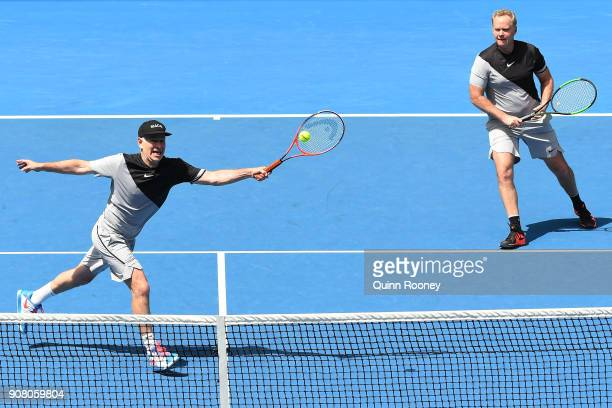 John McEnroe of the United States and Patrick McEnroe of the United States compete in their legend's match against Mansour Bahrami of France and...