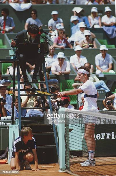 John McEnroe of the United States argues a point with the umpire during the Men's Singles Semi Final match at the French Open Tennis Championship on...
