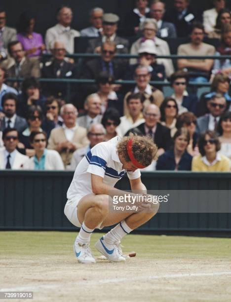 John McEnroe of the United States drops to his knees during the Men's Singles Final match against Bjorn Borg at the Wimbledon Lawn Tennis...