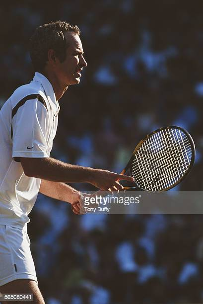 John McEnroe of the United States during his Mixed Doubles match with Steffi Graf at the Wimbledon Lawn Tennis Championship on 2 July 1999 at the All...