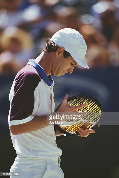 John McEnroe of the United States during the Men's Singles match at the Australian OpenTennis Championship on 20 January 1992 at the Melbourne Park...