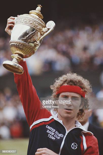 John McEnroe of the United States holds aloft the championship trophy after defeating Bjorn Borg to win the Men's Singles Final match at the...