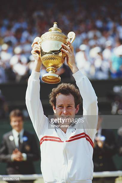John McEnroe of the United States holds aloft the championship trophy after defeating Jimmy Connors to win the Men's Singles Final match at the...