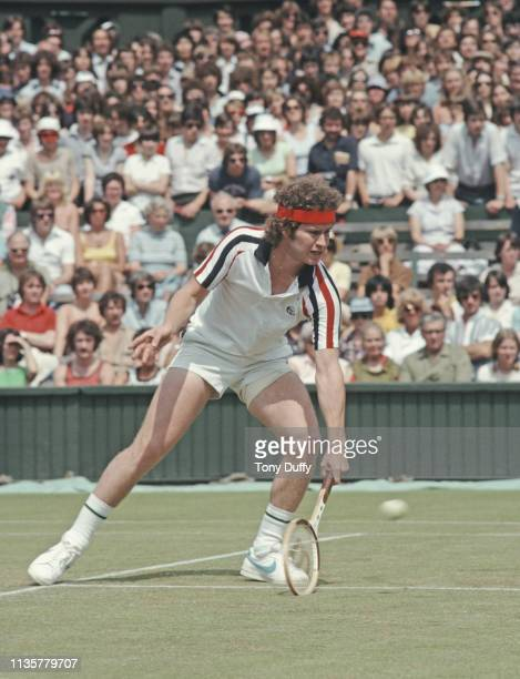 John McEnroe of the United States makes a low forehand return against Buster Mottram during their Men's Singles second round match at the Wimbledon...
