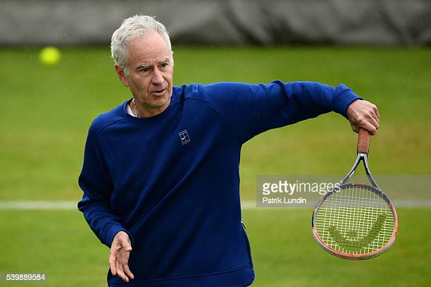John McEnroe of the United States practices with Andy Murray of Great Britain at Queens Club on June 13 2016 in London England