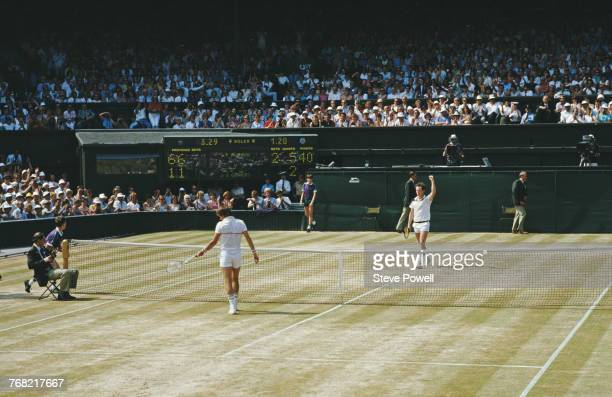 John McEnroe of the United States raises his arm in celebration after defeating Jimmy Connors 61 61 62 during their Men's Singles Final match at the...