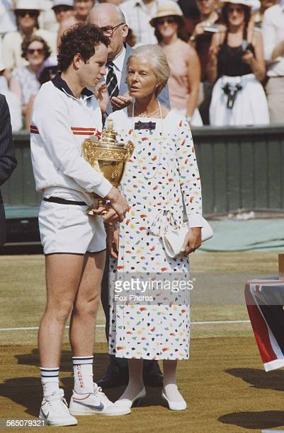 John McEnroe of the United States receives the trophy from the Duchess of Kent after defeating Jimmy Connors during the Men's Singles Final match at...