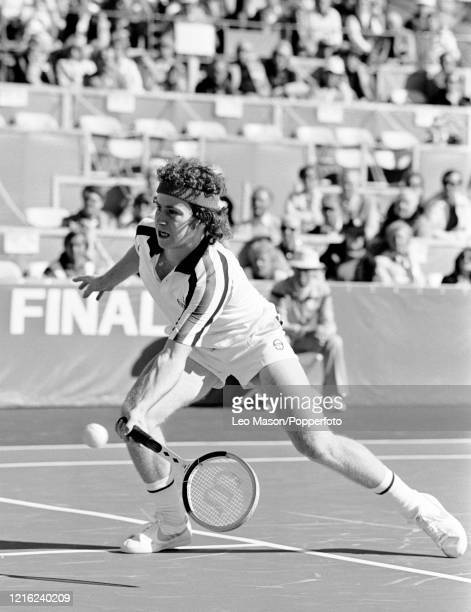 John McEnroe of the United States returns the ball against Buster Mottram of Great Britain in the 4th rubber of the 1978 Davis Cup Final at the...
