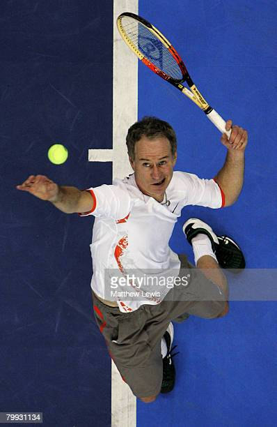 John McEnroe of the United States serves against Bjorn Borg of Sweden during the second day of the BlackRock Tour of Champions at the Odyssey Arena...