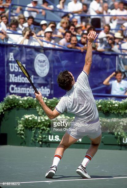 John McEnroe of the United States serves during a match in the Men's 1985 US Open Tennis Championships circa 1985 at the National Tennis Center in...