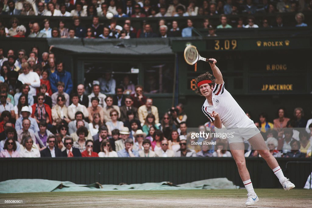 John McEnroe of the United States serves during the Men's Singles Final match against Bjorn Borg at the Wimbledon Lawn Tennis Championship on 6 July 1980 at the All England Lawn Tennis and Croquet Club in Wimbledon in London, England.