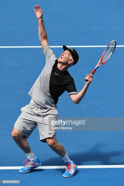 John McEnroe of the United States serves in his legend's match with Patrick McEnroe of the United States against Mansour Bahrami of France and...