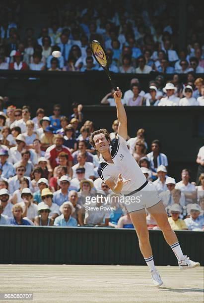 John McEnroe of the United States serving to Jimmy Connors during the Men's Singles Final match at the Wimbledon Lawn Tennis Championship on 8 July...
