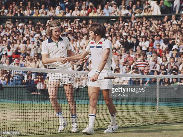 John McEnroe of the United States shakes the hand of compatriot Jimmy Connors during the Men's Singles Semi Final match at the Wimbledon Lawn Tennis...
