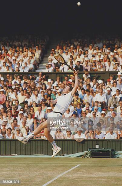 John McEnroe of the United States stretches to return a shot against Jimmy Connors during the Men's Singles Final match at the Wimbledon Lawn Tennis...