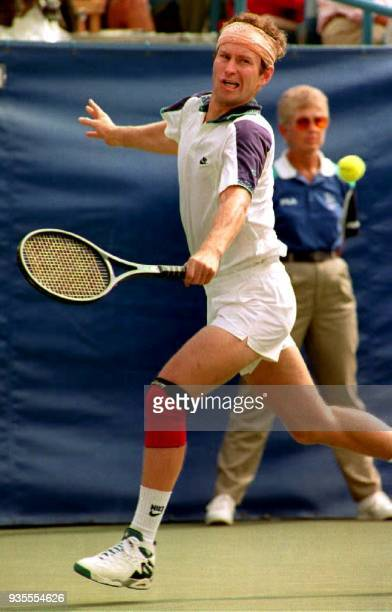 John McEnroe of the US returns the ball to Australia's Richard Fromberg 05 September 1992 at the US Open McEnroe is seeded 16th in the tournament /...