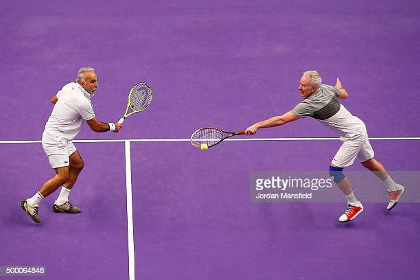 John McEnroe of the USA and Mansour Bahrami of France in action in their doubles match against Pat Cash of the USA and Mikael Pernfors of Sweden...