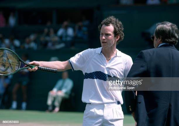 John McEnroe of the USA argues with an official on Centre Court during the Wimbledon Lawn Tennis Championships at the All England Lawn Tennis and...
