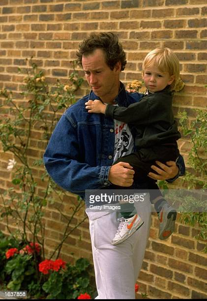 John McEnroe of the USA carries his baby daughter Mandatory Credit Allsport UK /Allsport
