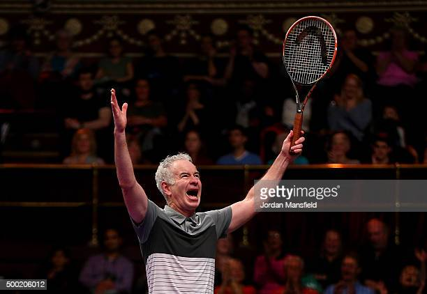 John McEnroe of the USA celebrates victory in his Legends Exhibition singles match against Henri Leconte of France during day five of the Masters...
