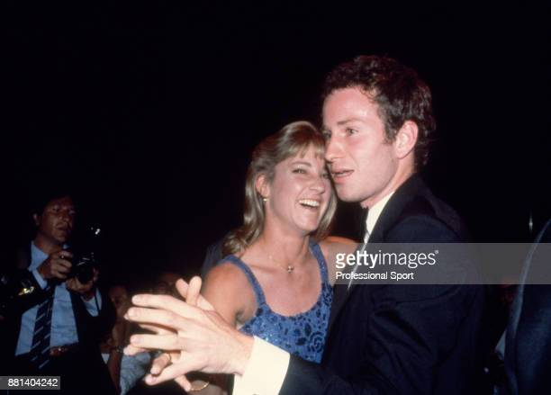 John McEnroe of the USA dancing with fellow tennis player Chris EvertLloyd at 'The Night of the Champions' event during the French Open Tennis...
