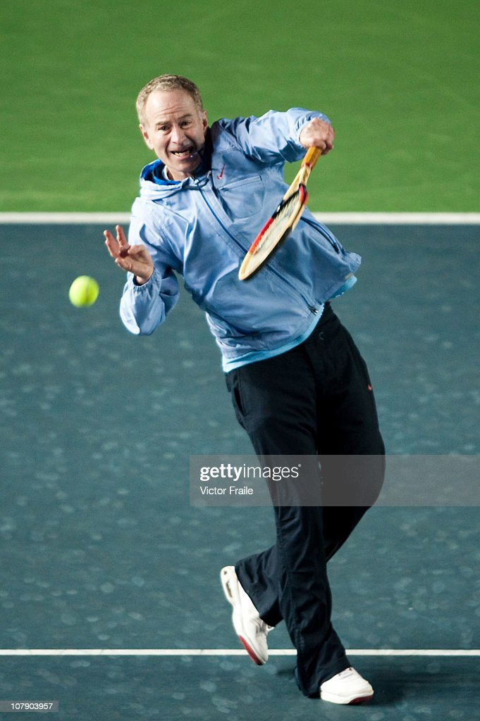 John McEnroe of the USA goes for the ball during his doubles match with Venus Williams of the USA against Vera Zvonareva and Yevgeny Kafelnikov of Russia on day two of the Hong Kong Tennis Classic at the Victoria stadium on January 6, 2011 in Hong Kong, China.