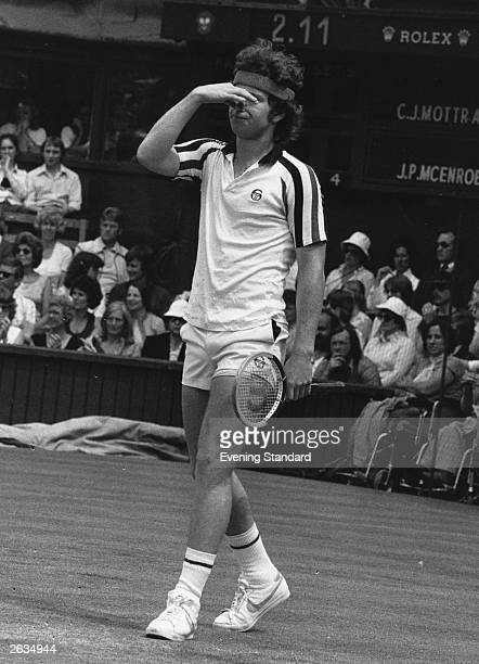 John McEnroe of the USA holds his nose in disgust after disagreeing with a linejudge during his match against Buster Mottram