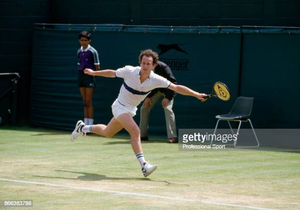 John McEnroe of the USA in action during the Wimbledon Lawn Tennis Championships at the All England Lawn Tennis and Croquet Club circa June 1985 in...