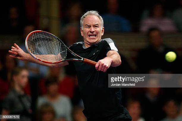 John McEnroe of the USA plays a backhand during his Tie Break Tens singles match against Tim Henman of Great Britain during day four of the Masters...