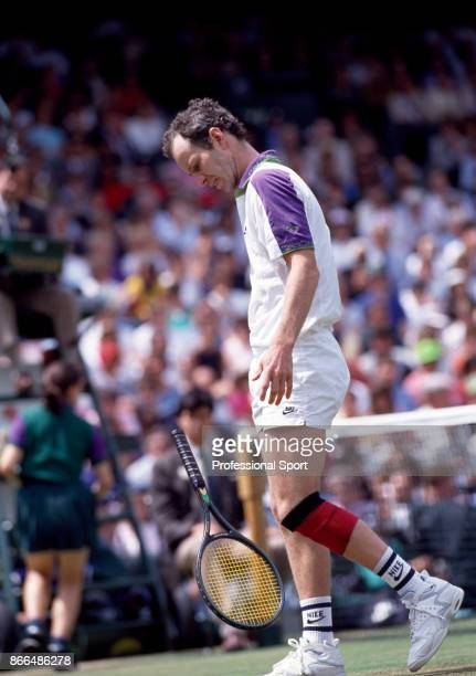 John McEnroe of the USA reacts during the Wimbledon Lawn Tennis Championships at the All England Lawn Tennis and Croquet Club circa June 1992 in...