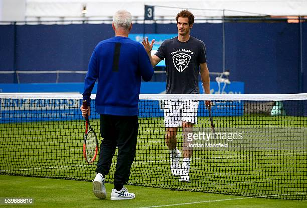 John McEnroe of the USA shakes hands with Andy Murray of Great Britain during a practice session on day one of the Aegon Championships at the Queens...