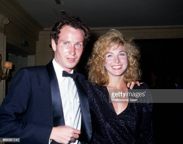 John McEnroe of the USA with his girlfriend Tatum O'Neal at the Players' Evening event during the French Open Tennis Championships at the Stade...