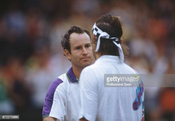 John McEnroe of the USA with Pat Cash of Australia at Wimbledon circa June 1992 Cash lost in the Second round to McEnroe in five sets sets