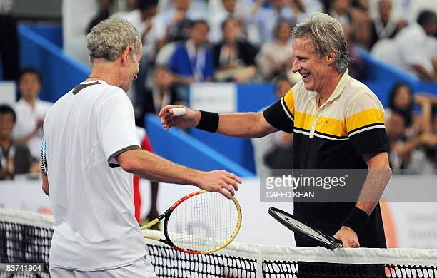 John McEnroe of USA and Bjorn Borg congratulate each other after an exhibition match against Bjorn Borg in Kuala Lumpur on November 18 2008 John...