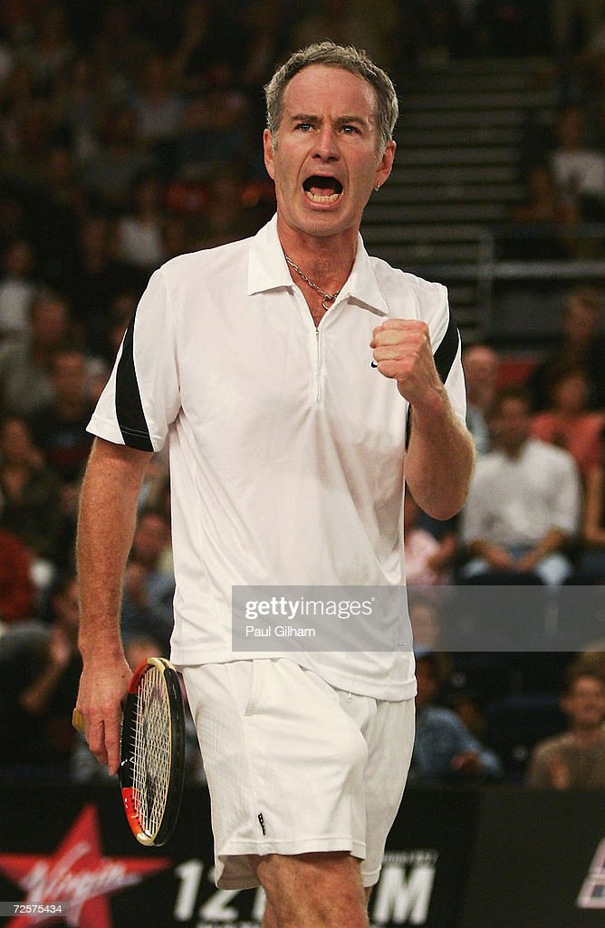 John McEnroe of USA celebrates his victory against Andrew Murray of Great Britain during the first round of the Superset Tennis tournament at Wembley Arena on October 3, 2004 in London.